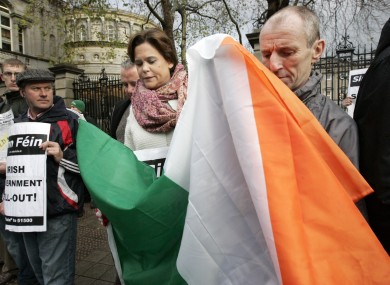 Does this constitute 'throwing around' the flag? Mary Lou McDonald at a Dáil protest in 2010.