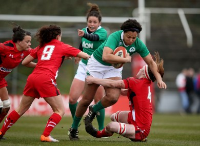 Sophie Spence drives through the Wales' defence.