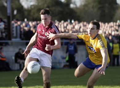 Roscommon's Conor Hussey in pursuit of Dylan Corbett of Galway.