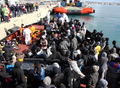 File photo of migrants attempting to disembark a ship in Italy.