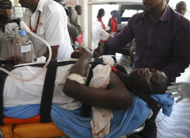 Medics help an injured person at Kenyatta national Hospital in Nairobi last Thursday