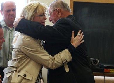 Henry Rayhons hugs members of his family after being found not guilty.