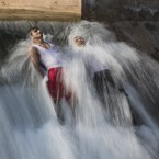 Pakistani men bathe in a stream to beat the heat on the outskirts of Islamabad.<span class=