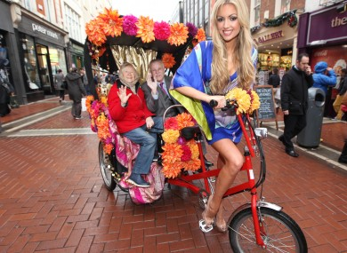 Rosanna Davison on a rather glamorous rickshaw in 2012 to promote the opening of an Indian restaurant.
