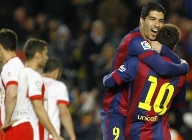 Luis Suarez and Lionel Messi celebrate together.