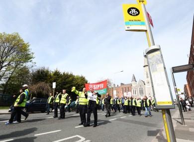 Dublin Bus and Bus Eireann workers march towards the Dail.