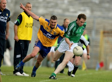 Enda Coughlan chases down current work colleague Seanie Buckley in 2009
