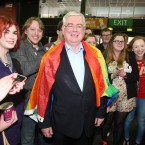 Eamon Gilmore gets into the spirit of things. <span class=