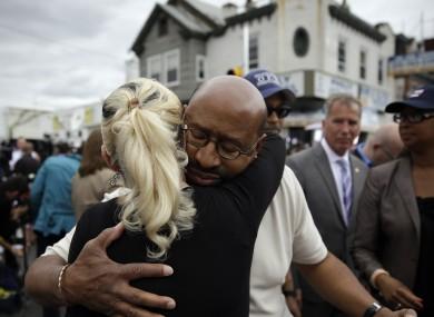 Philadelphia Mayor Michael Nutter consoles a nearby resident