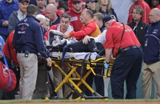 Fan left fighting for her life after being hit by broken bat which flew into the crowd
