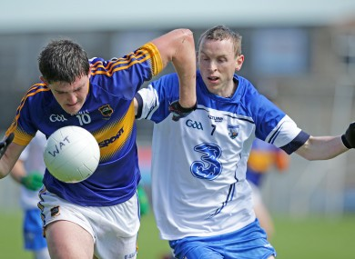 Colin O'Riordan bursts past Waterford's Maurice O'Gorman.