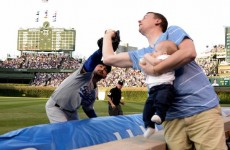 Man bottle-feeding his 7-month-old son in one hand makes incredible catch with the other