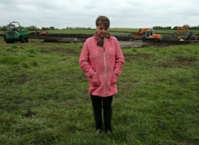 Maria Lynskey on farmland in Coghalstown where it's believed the body of her uncle is buried.
