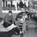 Students sing Christmas carols in this 1958 image. <span class=