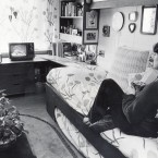 In the earlu 1980s, TVs started appearing in dorm rooms. Look how small that bed is though. <span class=