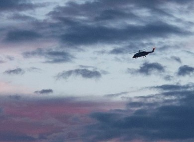 A Coast Guard helicopter at the scene.