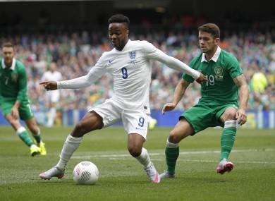 England's Raheem Sterling, left, wins the ball from Ireland's Robbie Brady.