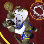 LeBron James reaches for the basket under pressure from Draymond Green during Game 6 of the NBA Finals in Cleveland.<span class=