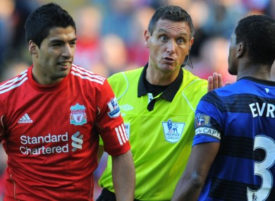 Luis Suarez and Patrice Evra.