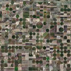 Centre-pivot irrigation, a way of watering crops with sprinklers, dot the square fields in West Kansas, USA. The majority are propelled by electric motors.