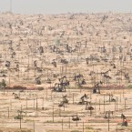 Depleting oil fields, like this one in Kern River Oil Field, California, are yet another sign of humans depleting the Earth's natural resources.<span class=
