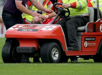 Alan O'Connor is wheeled away after suffering the injury against Kildare last Saturday.
