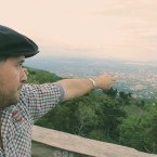 Activist Juan Valencia, on the San Salvador volcano, looks down on his native city.