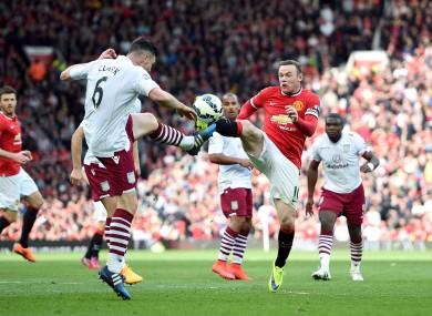 Man United captain Wayne Rooney and Villa's Irish defender Ciaran Clark.