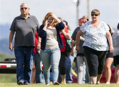 Parents and students leave after reuniting with their children following a