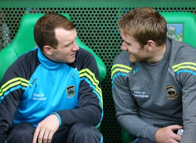 McGrath, right, chats to Lar Corbett on the bench during the Munster SHC semi-final. McGrath is