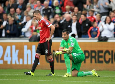 Man United keeper Sergio Romero looks dejected after conceding.