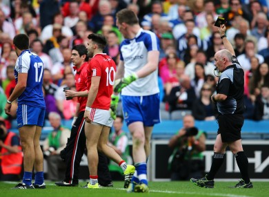 Tiernan McCann is shown a black card by referee Marty Duffy.