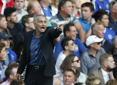 Chelsea manager Jose Mourinho points to his players as he watches his side from the touchline during the English Premier League match between Chelsea and Arsenal.