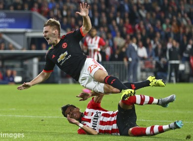 Luke Shaw is tackled by PSV Eindhoven's Héctor Moreno in a collision that resulted in a double leg fracture for the Manchester United left-back.