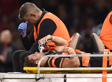 Leigh Halfpenny leaves the field on a stretcher during the World Cup warm up match at the Millennium Stadium.
