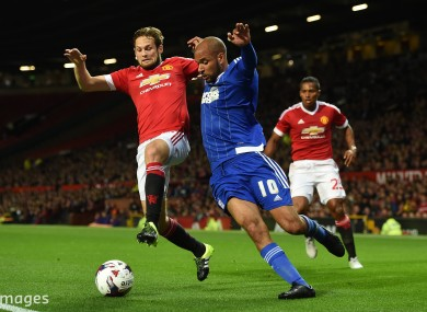 Daley Blind challenges David McGoldrick of Ipswich Town in tonight's Capital One Cup third-round tie at Old Trafford. The Red Devils are home to 'Boro in the next round.