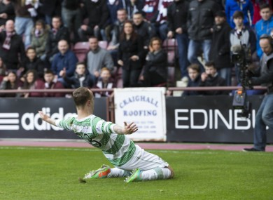 Celtic's Leigh Griffiths celebrates in front of Hearts fans after scoring at Tynecastle in February 2014.