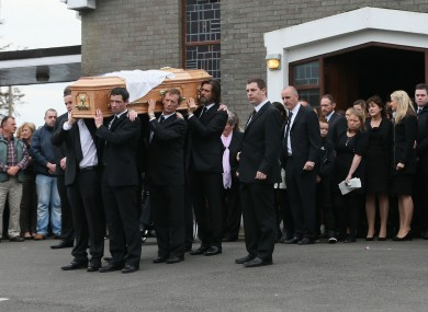 Jim Carrey helps carry the coffin of ex-girlfriend Cathriona White to Our Lady of Fatima Church, in her home village of Cappawhite, Co Tipperary.