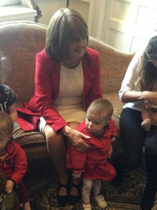 Joan Burton with some young children at a Labour event in Dublin today
