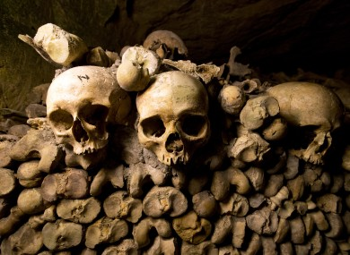 Skulls and bones are stacked at the Catacombs in Paris, France.