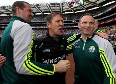 Jack O'Connor celebrates All-Ireland minor football success with his backroom team.