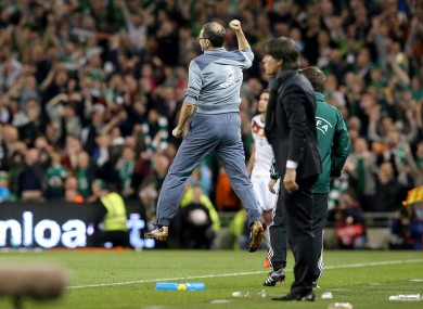 O'Neill jumps into the air as Shane Long scores the winner.