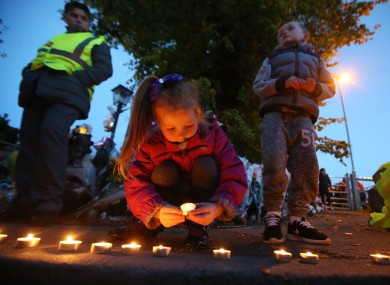 A vigil is held in the days after the Carrickmines tragedy.