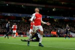First half goals from �zil and Sanchez keep Gunner's hopes alive