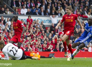 Gerrard watches on as Demba Ba scores the first goal in Chelsea's 2-0 win at Anfield in 2014, which helped cost Liverpool the title.