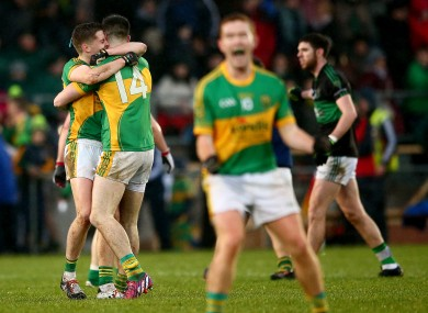 Fergal Condon and Michael Quinlivan celebrate at the final whistle.