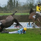 Ger Fox on Strongpoint and Adrian Heskin on  Sammy Black both crash out during racing at Fairyhouse.<span class=