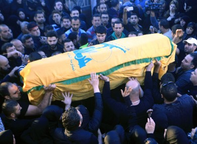 Relatives and friends carry the coffin of Hezbollah member Adel Termos, who was killed in Thursday's twin suicide bombings.