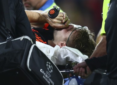 Luke Shaw is carried off the pitch after suffering a double leg break in Eindhoven.