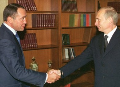 Russian President Vladimir Putin (right) with Mikhail Lesin in 2002.